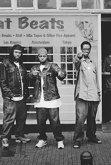 T3, J Dilla, and Baatin in front of Fat Beats Amsterdam.