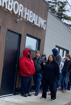 People lined up to buy recreational cannabis at Ann Arbor Healing, one of the first stores to be granted a license to sell.