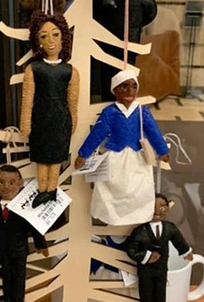 Display of Black dolls hanging from a tree at Michigan State University.