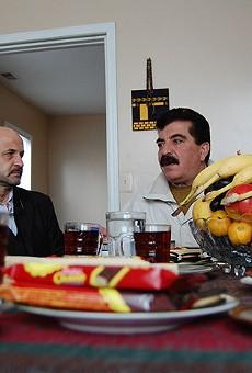 Samir Alrashdan, right, and landlord Bashar Imam in Hamtramck.
