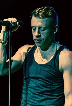 Macklemore performing in Toronto during The Heist Tour on 28 November, 2012. Photo from Wikipedia, used under creative commons; image taken by Drew of The Come Up Show.