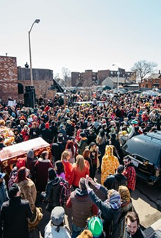 Detroit's Marche du Nain Rouge parade draws thousands.