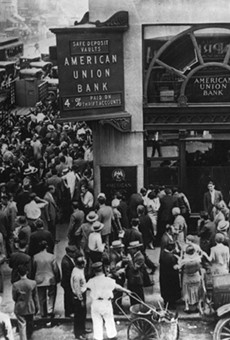 Crowd at New York's American Union Bank during a bank run early in the Great Depression.