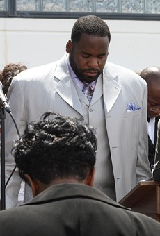 Kwame Kilpatrick and other officials at a public prayer rally.