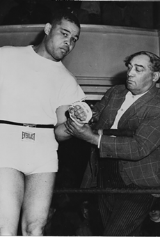 "Joe Louis, left, and the intriguing Henry Johnson, right. Referred to in Maraniss' account as ""Pappa Dee,"" a driver, Johnson was a hustler in the black community who ran a barbershop and ""managed"" boxers."