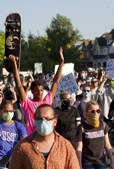 Peaceful protesters marched on Gratiot on Tuesday before 127 of them were arrested.