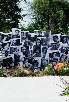 Lisa Waud's latest floral installation, located at the intersection where Malice Green was killed by Detroit Police in 1992, honors other Black people who were slain. The installation is up until the end of the day on Saturday.