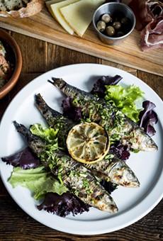 Sardinas Asadas – grilled fresh sardines, with grilled lemon, and tarragon at La Feria in the Cass Corridor.