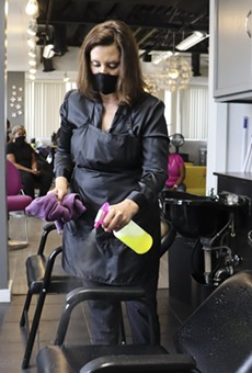 Gov. Gretchen Whitmer at Reflections Hair Salon in Grand Rapids, where she helped clean equipment.
