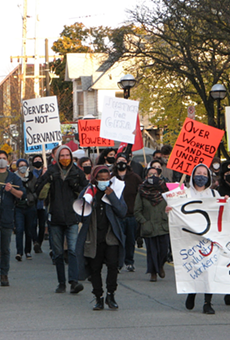 Members of the Service Industry Workers of the Ann Arbor Area (SIWA3) march in October.