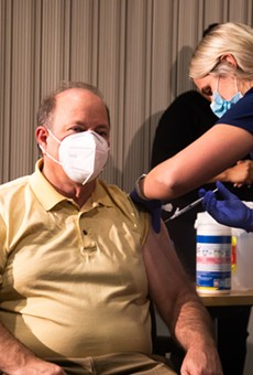 Detroit Mayor Mike Duggan got vaccinated for COVID-19 at a televised news conference as part of a campaign to build trust in the state's Black communities.