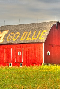 """A barn with """"M Go Blue"""" on the roof."""