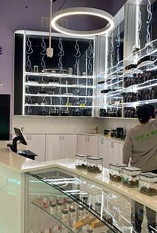 A growing industry: Leaf and Bud's neon-accented sales floor. The new dispensary claims to be Detroit's largest.
