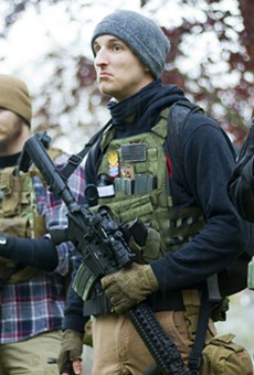 Armed protesters at a rally against Michigan's COVID-19 restrictions in May 2020.