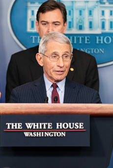 Dr. Anthony Fauci, center, is the Trump whisperer.