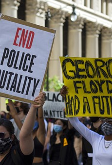 Protesters march in Detroit following the death of George Floyd last year.
