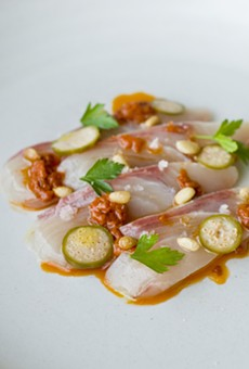Hamachi with calabrese chili, pine nut, and caperberries.