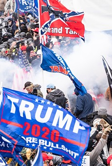 Smoke rises after police used pepper spray against Pro-Trump supporters on Jan. 6, 2021.