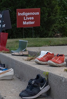 Shoes and toys at a memorial by a Catholic church in Toronto in tribute to 215 indigenous children whose remains were found in a school in Kamloops, British Columbia.