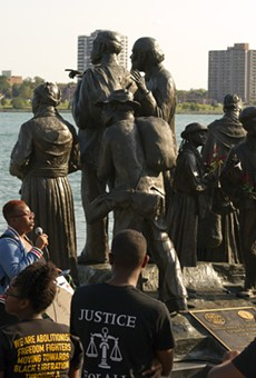 Black activists rally against racism next to an Underground Railroad monument in Hart Plaza in Detroit.
