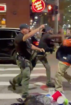 Screenshot of video showing a Detroit cop punching a man in the face in Greektown.