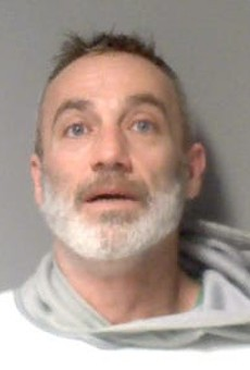 Michael Varrone is accused of phoning in a bogus bomb threat and threatening state Rep. Cynthia Johnson, D-Detroit.