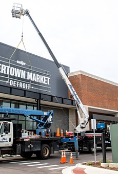 Workers are putting the finishing touches on Detroit's Meijer Rivertown Market.