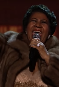 """Franklin performing at the Kennedy Center Honors Ceremony in 2015, moments before the """"fur coat drop."""""""