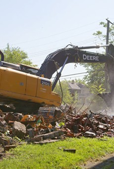 The Detroit Land Bank knocks down a dilapidated house on the city's west side in September 2015, when Detroit averaged 150 demolitions a week.