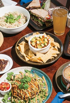 (Counterclockwise from bottom left) Tostada, magic bar, Michigan Salad, Arugala Alfredo, ABLT, s mug of Neu Kombucha, Thai pasta salad, lima bean corn chowder, Southwest Appetizer w/sloppy joe (center).