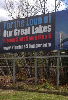 Billboards demanding the shutdown of Line 5 appeal to motorists on both sides of the Mackinac Bridge.