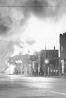 Fire from burning buildings light up the night sky on Detroit's west side.