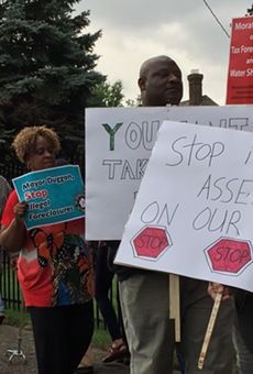 "Protesters call on the Wayne County Treasurer to halt the auction until the problem of ""illegal tax assessments"" can be resolved."