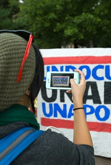 """People protest President Donald Trump's announcement to end the Deferred Action for Childhood Arrivals program at a """"Defend DACA"""" rally in Clark Park in Southwest Detroit on Tuesday, Sept. 5."""