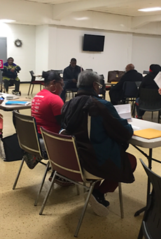 Volunteers help Detroit residents facing tax foreclosure apply for assistance to stay in their homes.