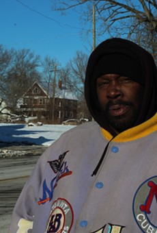 Lawrence Cole, a homeless man from Detroit, says he sleeps in a vacant house under a pile of coats to keep warm.