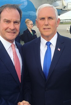 Michigan Attorney General Bill Schuette poses with Vice President Mike Pence.