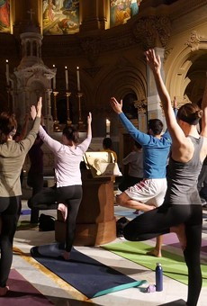 Yogis in tree pose during a Ignatian Yoga flow.