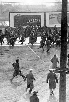Demonstrators on Miller Road outside of the Rouge Plant flee as tear gas and bullets are released on them by Dearborn Police and Ford Servicemen during the 1932 Ford Hunger March.