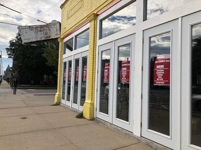 Hiring signs appear in the windows of the long-vacant space at the corner of Willis St. and Cass Ave. - PHOTO BY DEVIN CULHAM