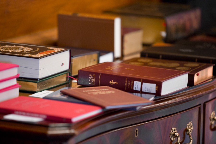 Bibles line the table adjacent to the staging area for the ceremonial swearing in. - ERIK PAUL HOWARD