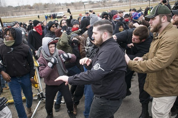 A neo-Nazi group and anti-fascist protesters clash at Michigan State University. - TOM PERKINS