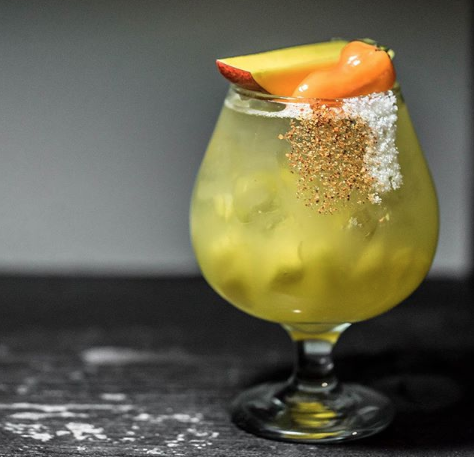 TheFederica Picosa consists of tequila, Triple Sec, citrus agave blend, mango, and habanero. - PESO BAR/INSTAGRAM