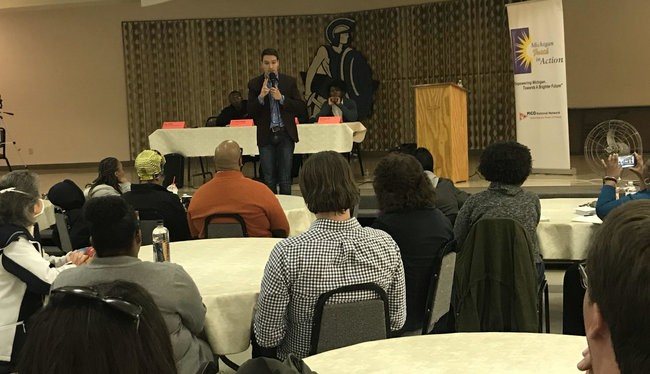 Igor Volsky with the group Guns Down America spoke at a town hall meeting Monday night in Flint. - SAM INGLOT/PROGRESS MICHIGAN