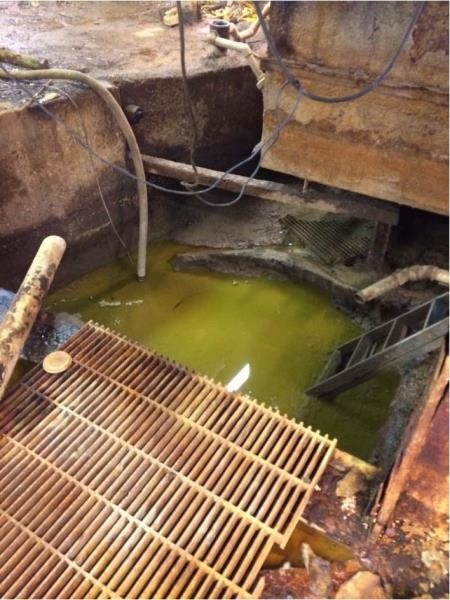 Pit in the basement at the factory responsible for toxic ooze on I-696. - U.S. ENVIRONMENTAL PROTECTION AGENCY