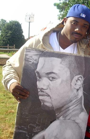 Ray-J holding a picture of Ray-J - PHOTO VIA WIKIPEDIA