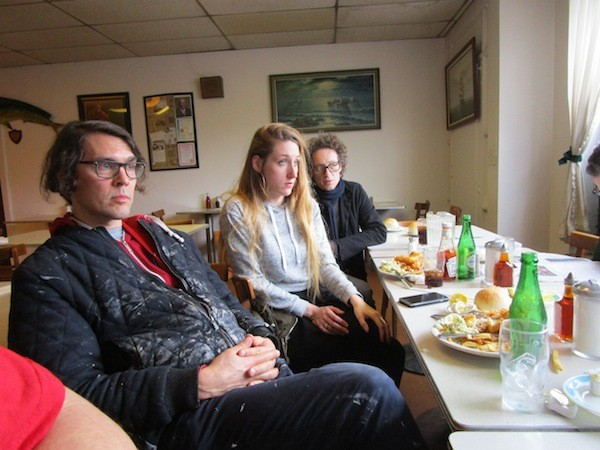 Ryan (far left) and Fabia (center) Mendoza settle in for fish and chips at Scotty Simpson's. - PHOTO BY MICHAEL JACKMAN