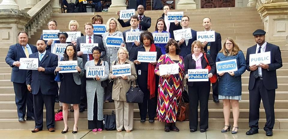 Michigan representatives who want an audit of DPS stand on the steps of the state Capitol. - FACEBOOK