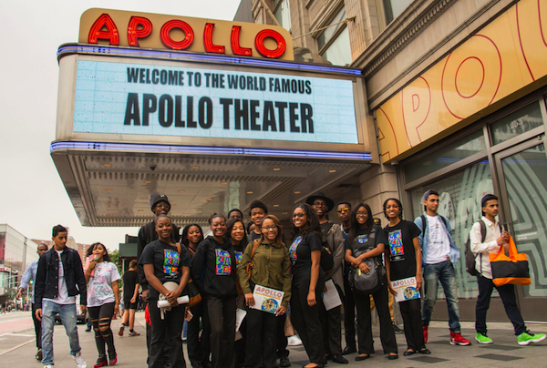 The Mosaic Youth Theatre group poses in front of New York's Apollo Theater. - PHOTO COURTESY MOSAIC YOUTH THEATER