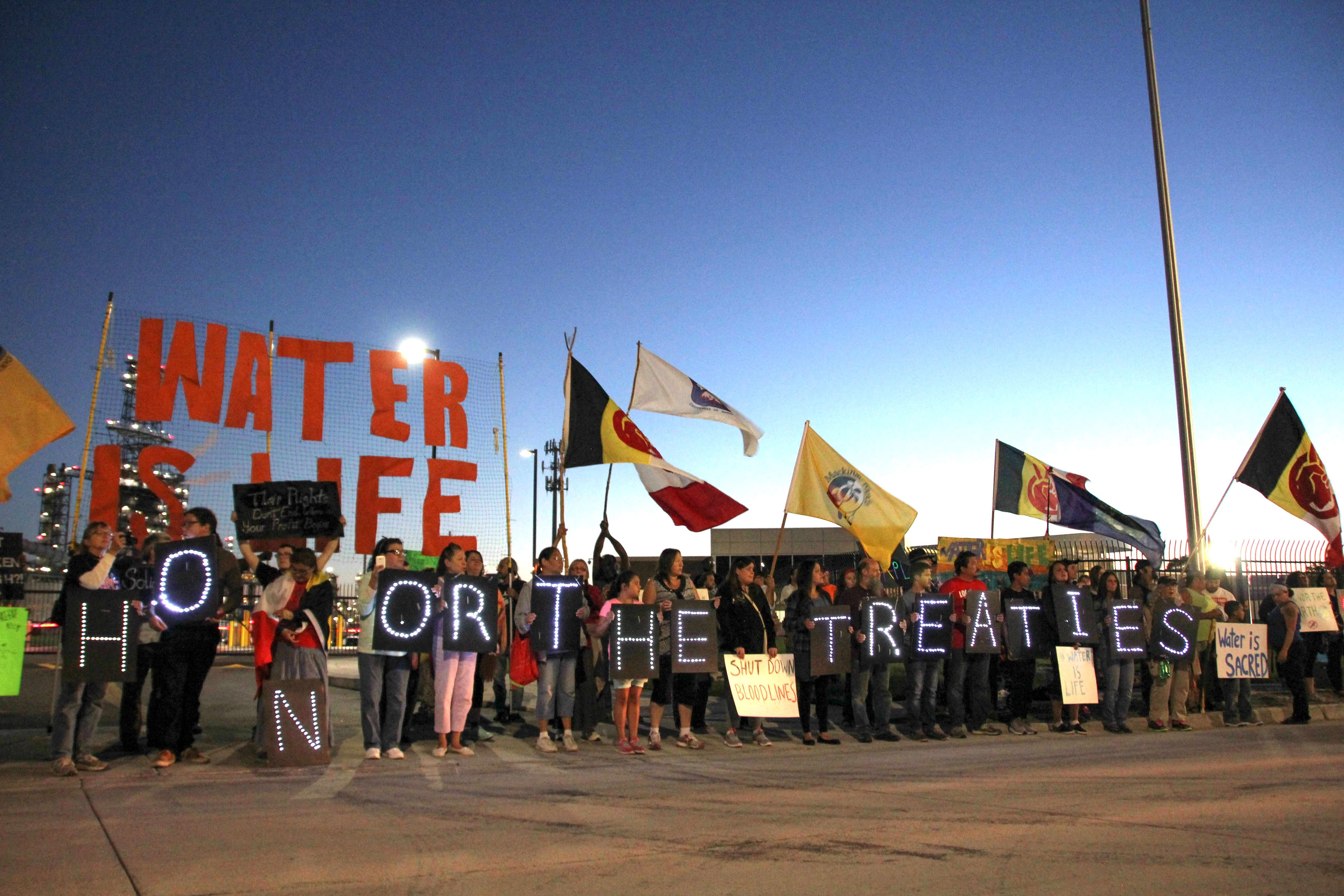 Protesters Gather At Marathon Oil Refinery In Support Of Standing